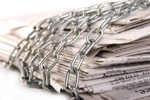 Chained uo newspapers